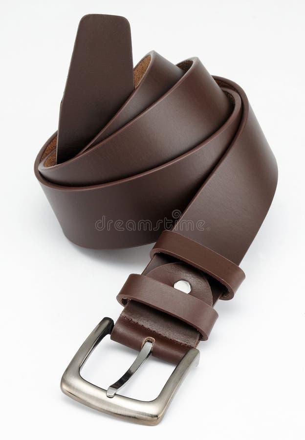 Brown leather belt. With metal sliver belt-buckle stock image