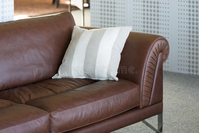 Brown leather bench in furniture showroom stock images