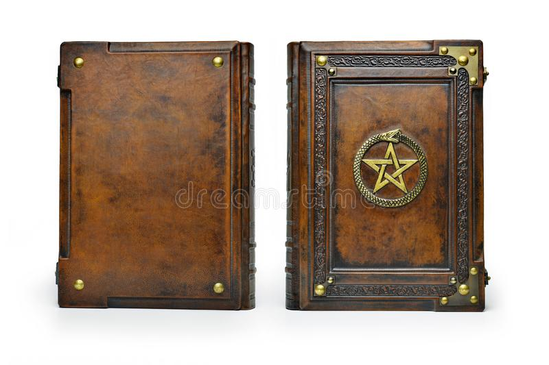 Brown leather book cover with gilded pentagram and the Ouroboros symbol, surrounded with deeply embossed frame and metal corners. Captured stand up frontal royalty free stock image