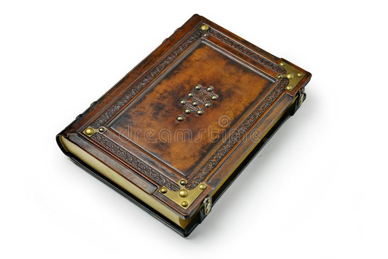 Brown leather book cover with the tree of life, Kabbalah symbol, surrounded with deeply embossed frame and metal corners. Captured lay down frontal royalty free stock photography