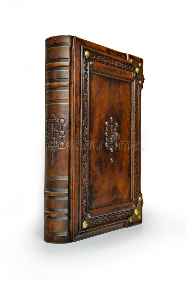 Brown leather book cover with the tree of life, Kabbalah symbol, surrounded with deeply embossed frame and metal corners. Captured stand up frontal stock image