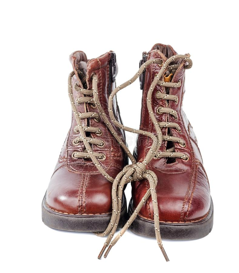 Brown leather boots. With zipper and shoe-laces isolated on white stock images