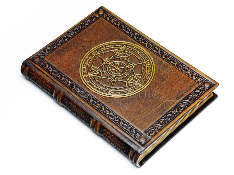 Brown leather bound book with a gilded transmutation circle in center of the front cover stock photography