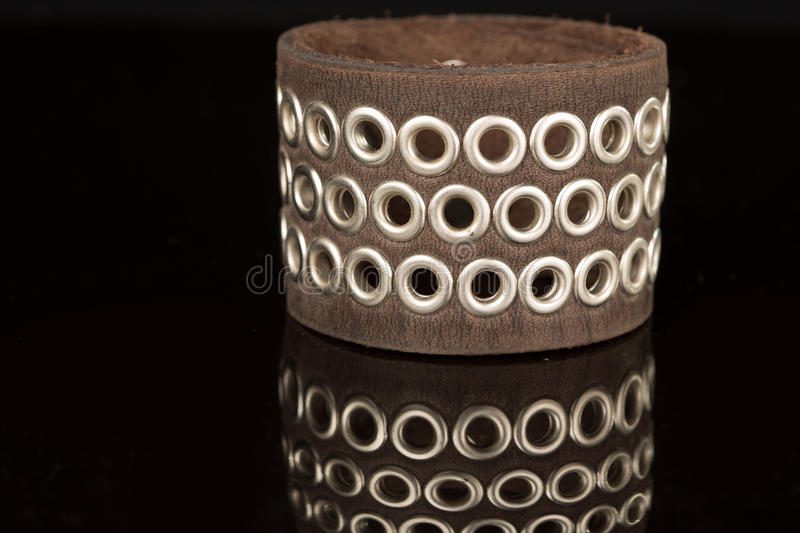 Brown leather bracelet isolated on a black. Background royalty free stock images