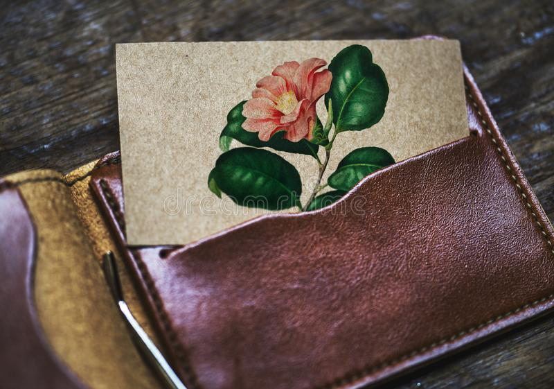 Brown Leather Card Wallet With Pink Petaled Flower Printed Card royalty free stock photography