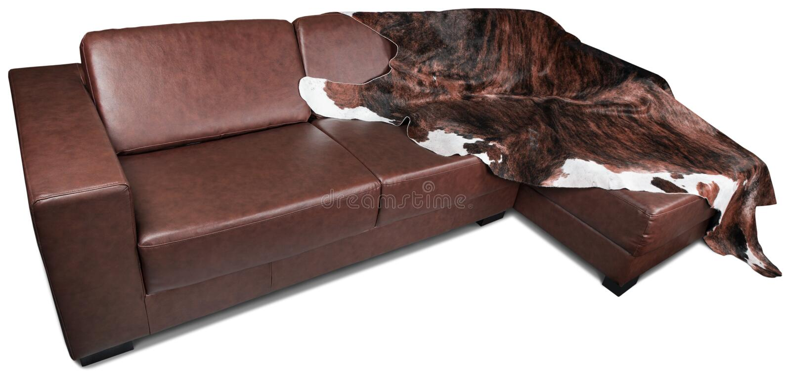 Brown Leather corner Sofa with Furry Blanket - royalty free stock image