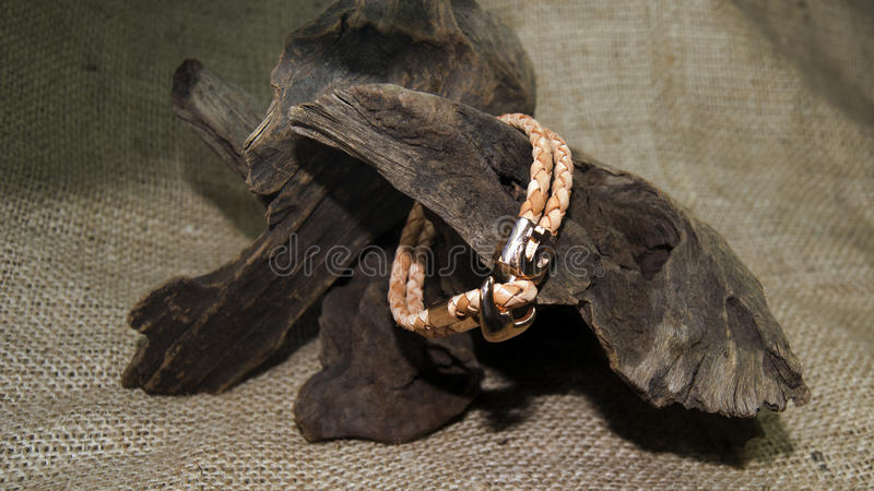 Brown leather men bracelet. On wicker royalty free stock photography