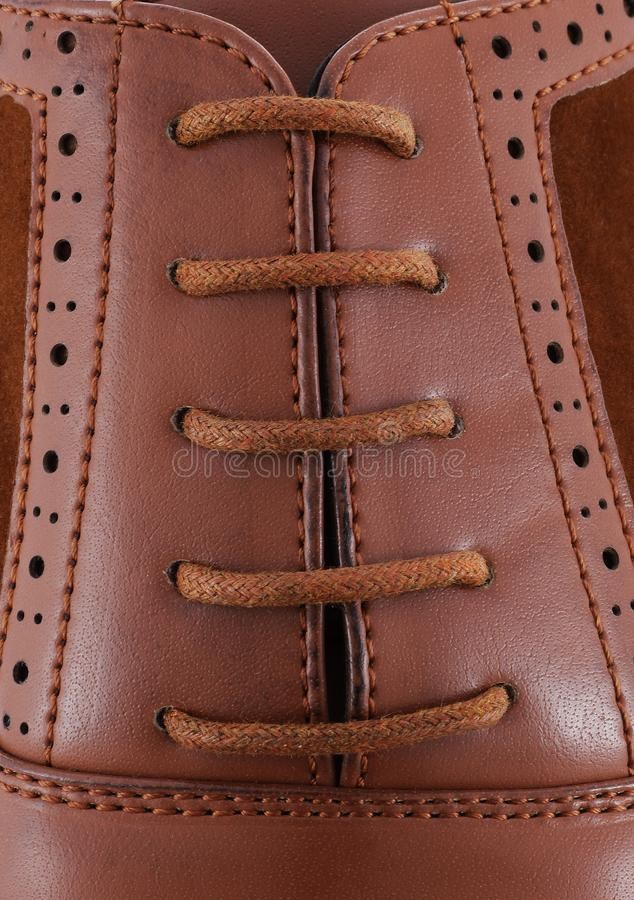 Brown leather men`s shoe with brown laces close-up stock photos