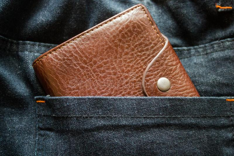 Buy, payment, cash, pay, economy, safe, euro, save, back, spend, dollar, business, finance, cotton, textured, textile, color, clot. Brown leather men`s wallet royalty free stock image