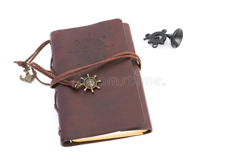 Brown leather notebook on a white background, compass stock photography