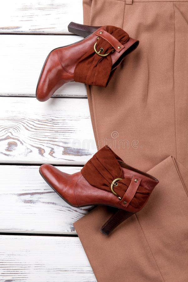 Brown leather shoes on trousers. royalty free stock photography