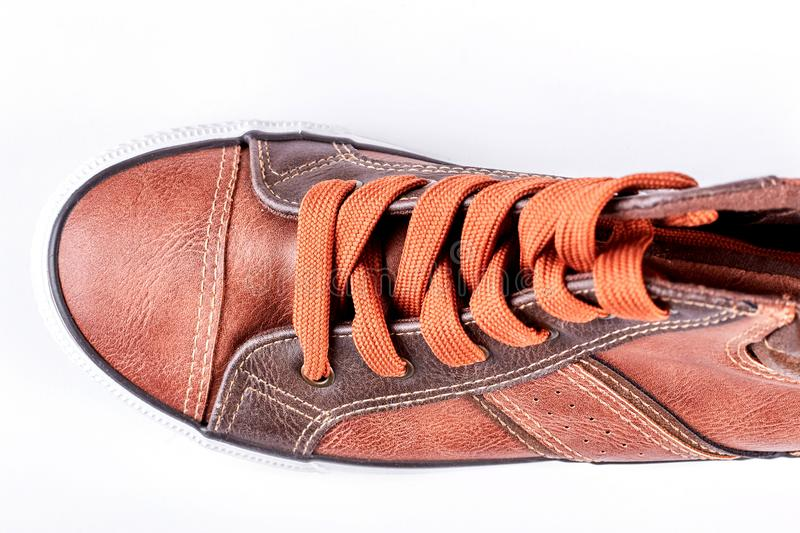 Brown leather sneakers with clipping path. Fashion sport shoe on white background, top view. New collectin of sport trainers royalty free stock photos