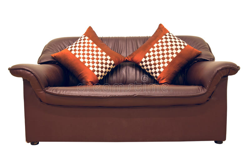 Brown leather sofa. A brown leather sofa with pillows isolated on the white royalty free stock images