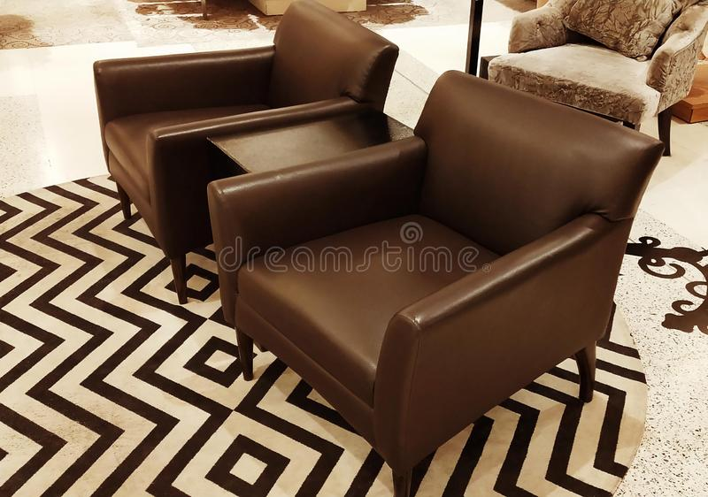 Brown leather sofa chairs in retro style. 2 brown leather sofa chairs in retro style stock photo
