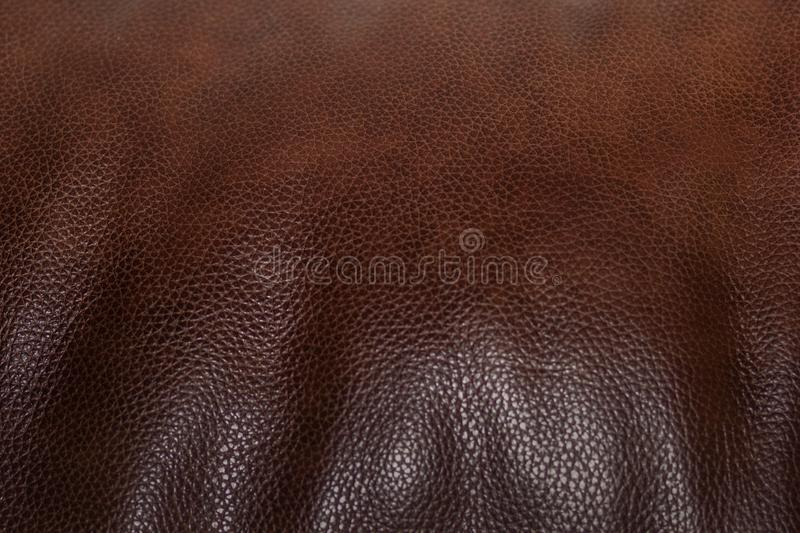 Brown leather texture as background. Grained. stock photos