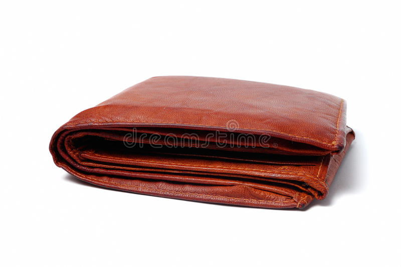 Brown leather wallet. An isolated brown leather wallet royalty free stock photo