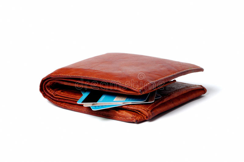 Brown leather wallet with credit cards. An isolated brown leather wallet with credit cards stock photo