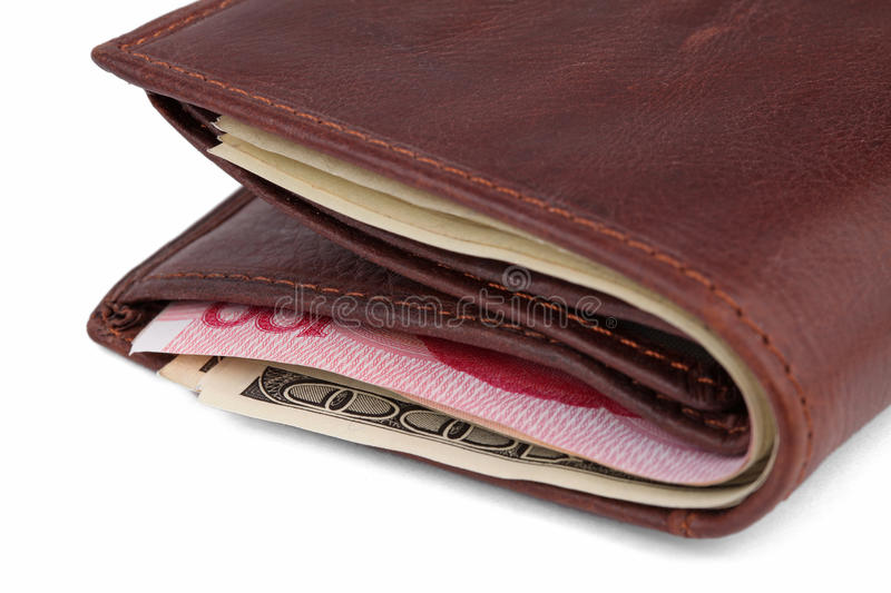 Brown leather wallet with dollars and yuans royalty free stock photography
