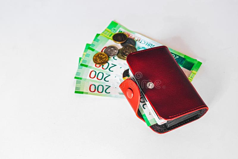 Brown leather wallet with plastic cards and Bank of Russia banknotes. Russian money for 200 rubles and coins royalty free stock photo