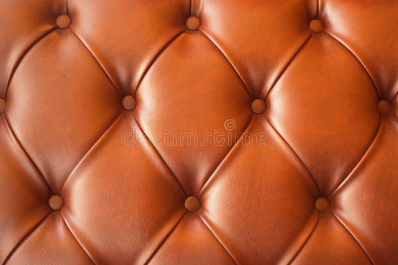 Brown-Leder der Sofabeschaffenheit stockbild