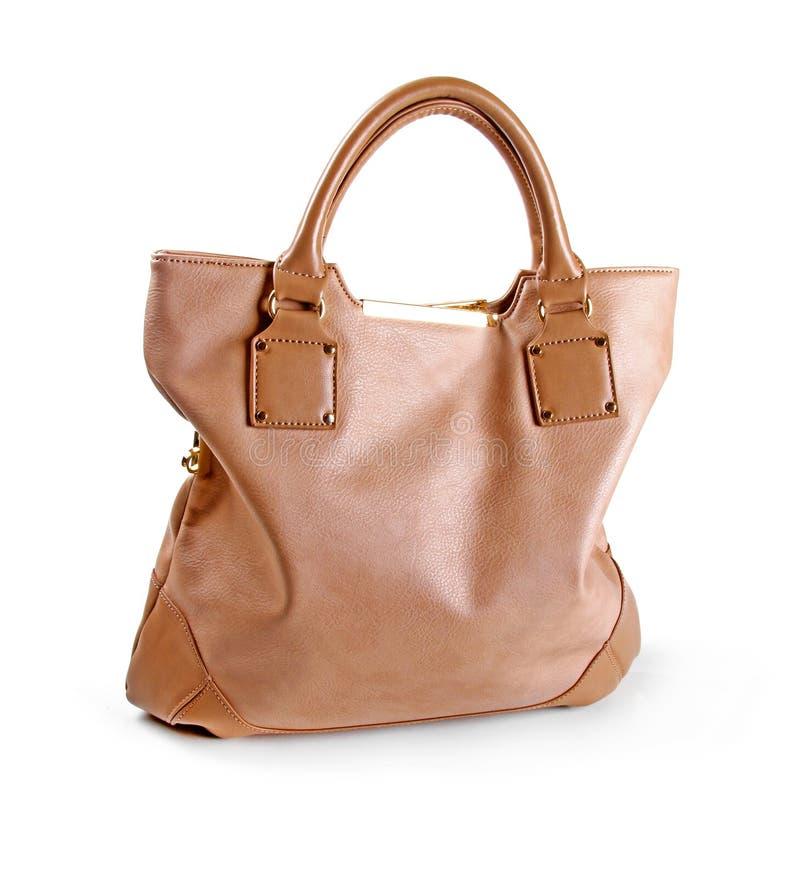 Brown-Lederfrauentasche lokalisiert auf Weiß stockfotografie