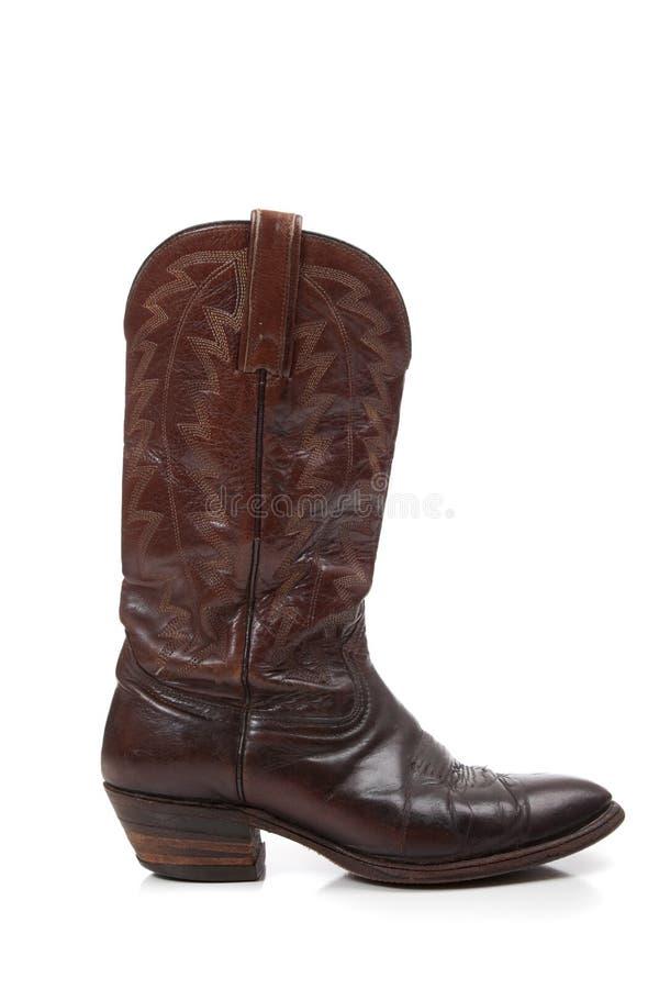 Brown-lederne Cowboystiefel auf Weiß stockbild