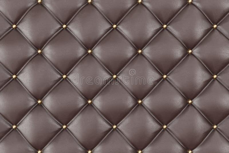Brown-Lederpolsterung Sofa Background Brown-Luxusdekorations-Sofa Elegante Brown-Leder-Beschaffenheit mit Knöpfen für stock abbildung