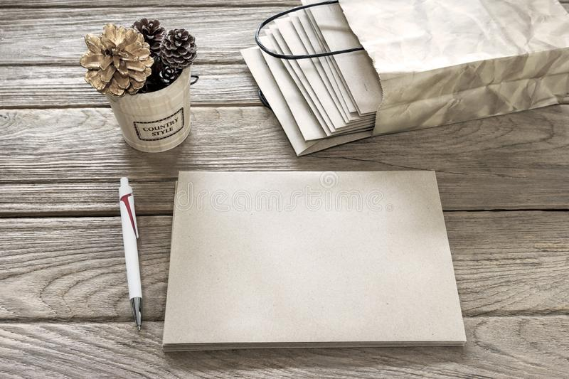 Brown Letter Envelop with pen on wooden table.  stock photography