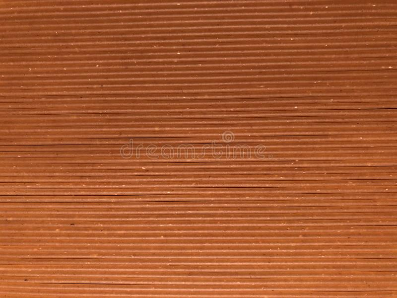 Brown and light brown wooden panel looking board, background, texture. royalty free stock images