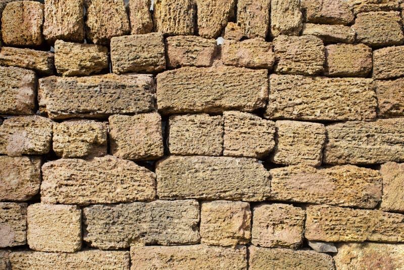 Brown limestone brick wall dry masonry. Brown limestone brick wall block background, dry masonry stock images