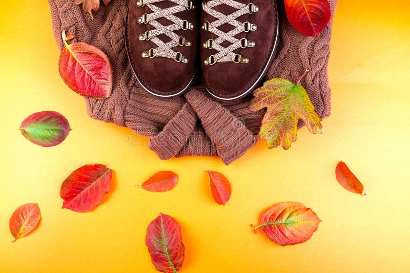 Brown man suede boots with sweater on yellow background royalty free stock photo