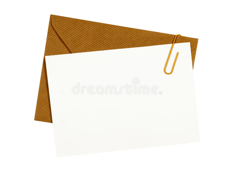 Brown manila envelope, blank letter or message card, paper clip, white copy space. Brown manila envelope, blank letter or message card, paper clip, copy space stock images