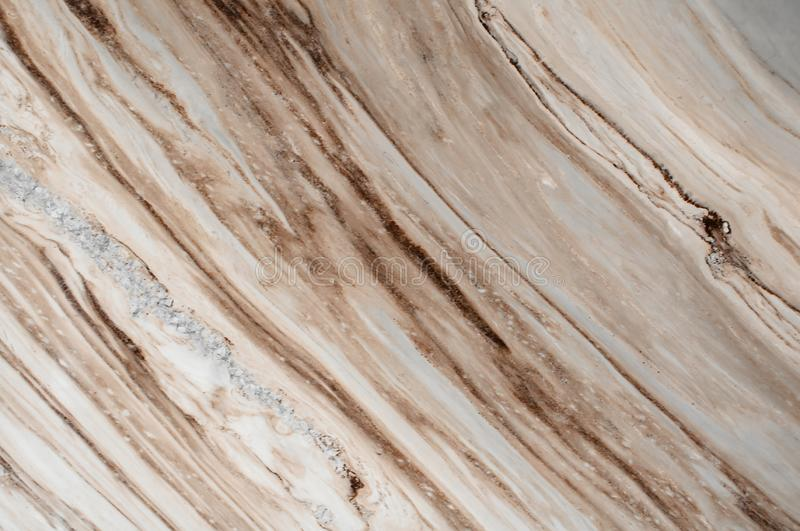 Brown marble stone background. Brown marble,quartz texture. Wall and panel marble natural pattern for architecture and interior de. Sign or abstract background royalty free stock image