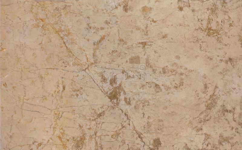 Brown marble wall or flooring pattern surface texture. Close-up of interior material for design decoration background royalty free stock image