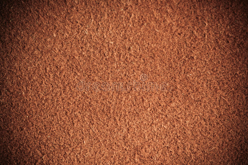 Brown maserte lederne Hautschmutz-Hintergrundnahaufnahme stockfotografie