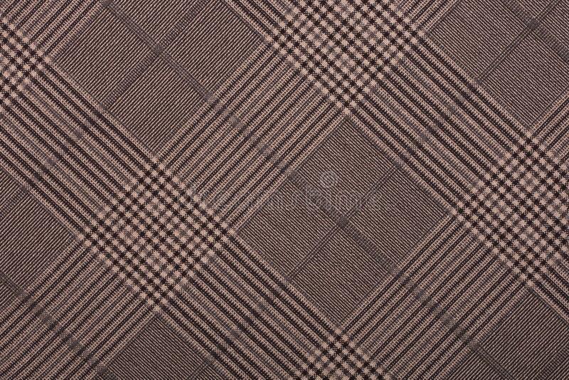 Brown-Material in den geometrischen Mustern, ein Hintergrund lizenzfreies stockfoto
