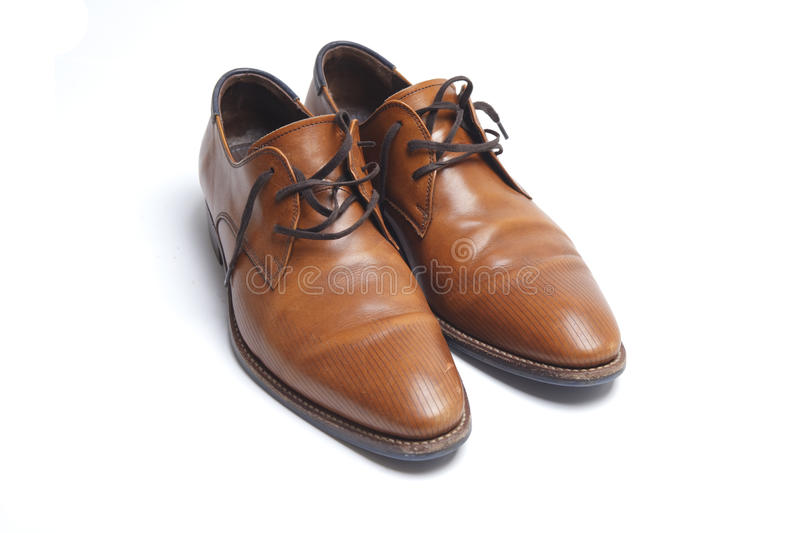 Brown mens shoes. Brown leather mens shoes on white stock photos