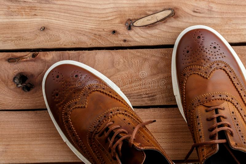 Brown mens shoes on wooden background. top view.  stock photos