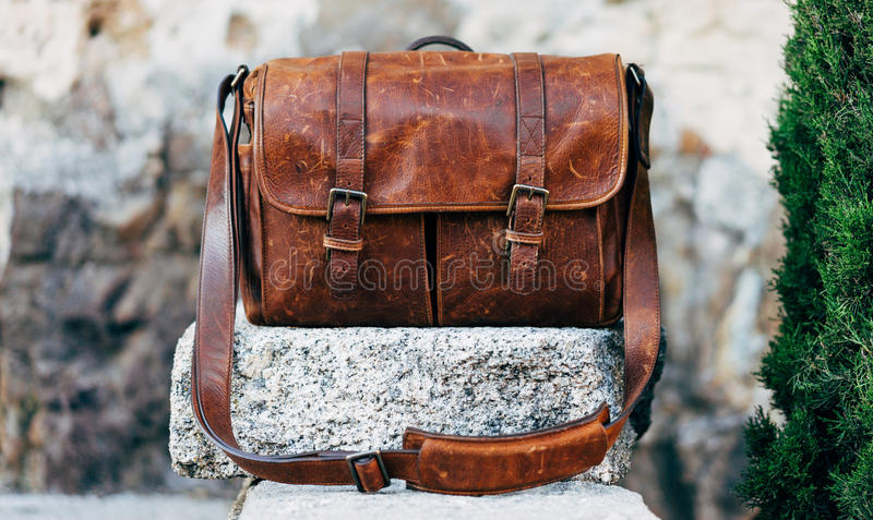 Brown Messenger Bag On Top Of Stone Free Public Domain Cc0 Image