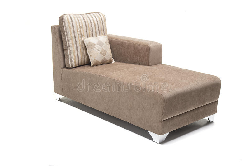 Brown modern looking lounger with cushions against white background made from highest quality linen. Beautiful looking lounger with cushions over it stock photo