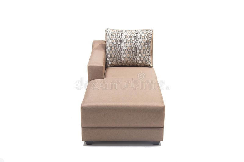 Brown modern looking lounger with cushions against white background made from highest quality linen. Beautiful looking lounger with cushions over it royalty free stock image