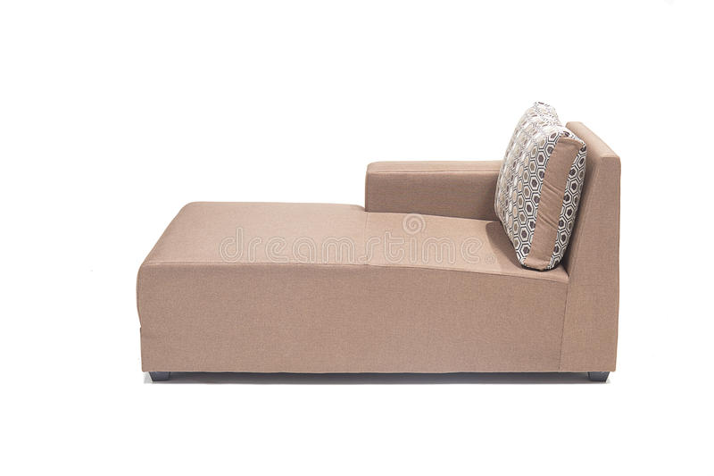 Brown modern looking lounger with cushions against white background made from highest quality linen. Beautiful looking lounger with cushions over it stock images