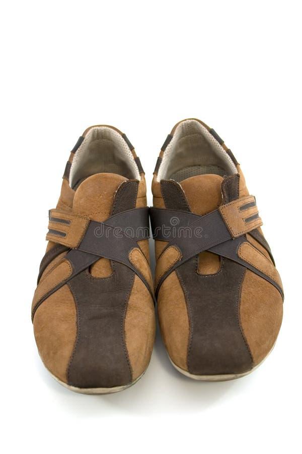 Brown moderno aislado se divierte los zapatos fotografía de archivo libre de regalías