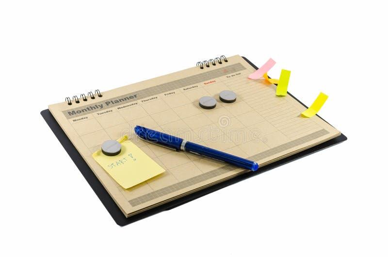 Brown-Monatsplaner mit Stift stockbild