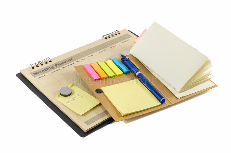 Brown-Monatsplaner mit Stift und notedbook stockfotografie