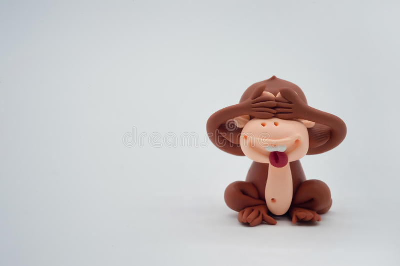 Brown monkey doll close eyes on white background royalty free stock images