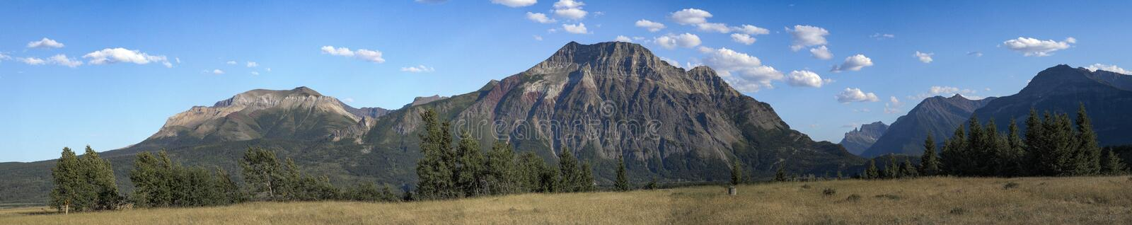 Brown Mountain Under Blue and White Sky stock images