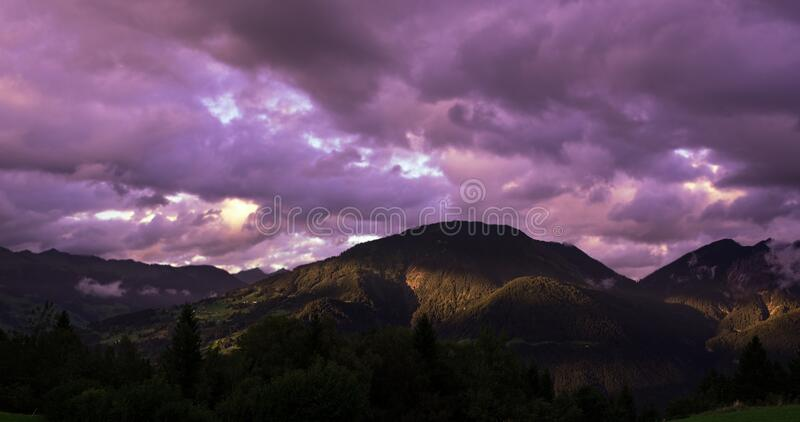 Brown Mountain Under Cloudy Sky during Sunset royalty free stock photos