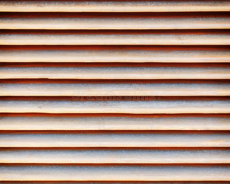 Wooden shutters closeup, seamless abstract pattern. Brown natural wood shutters closeup, seamless abstract pattern stock image