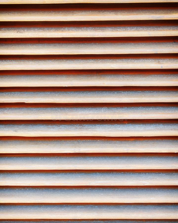 Wooden shutters closeup, seamless abstract pattern. Brown natural wood shutters closeup, seamless abstract pattern royalty free stock photography